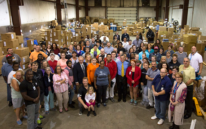 Picture of Governor Carney with hard working Delawareans.