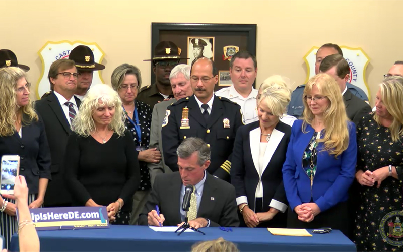 Picture of Governor Carney signing into law major reforms to expand access to substance abuse treatment.