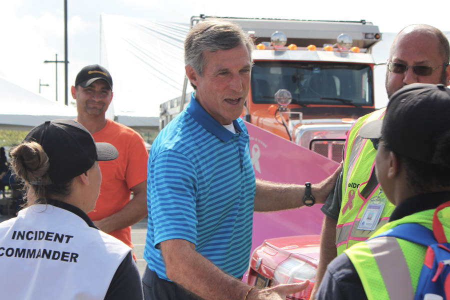 Image of the Governor talking with a highway worker.