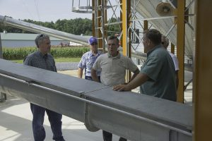 Image of a Governor Carney visiting a farm