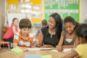 Picture of a teacher Helping Students with Questions