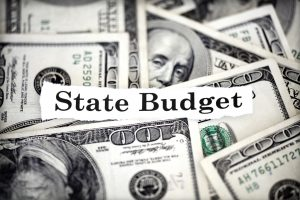 Image of dollars with words state budget