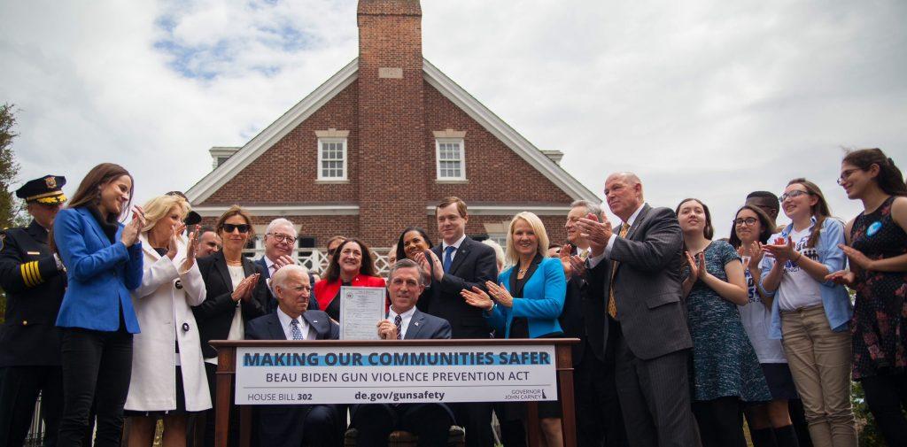 Governor Carney signs Beau Biden Act alongside Vice President Biden, Dr. Biden, Ashley Biden, Hallie Biden, Rep. Bentz and others